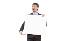 Smiling business man showing blank signboard Stock Photos