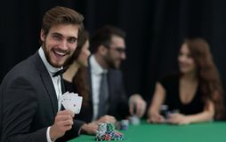 Smiling business man showing four aces stock photography