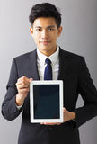 Smiling business man showing tablet pc Royalty Free Stock Images