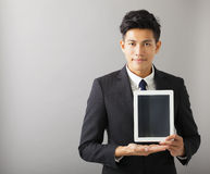 smiling business man showing tablet pc Stock Image