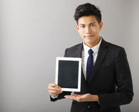 Smiling business man showing tablet pc Royalty Free Stock Image