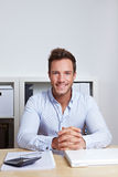 Smiling business man sitting stock photography
