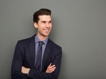 Smiling business man standing with arms crossed Royalty Free Stock Images