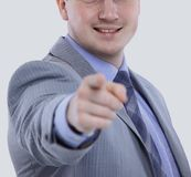 Young business man in a suit pointing with his finger. Smiling business man in a suit pointing with his finger Royalty Free Stock Images