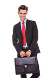 Smiling business man with a suitcase Royalty Free Stock Images