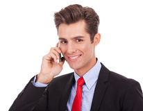 Smiling business man talking on his smartphone Stock Photo