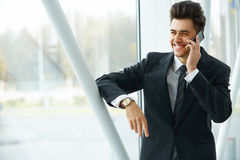 Smiling Business Man Talking on Mobile Phone Stock Photos