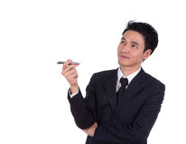 Smiling business man thinking Royalty Free Stock Images