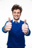 Smiling business man with thumbs up. Over white background stock photos