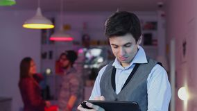 Smiling business man typing tablet pc looks to camera, HoReCa. Stock footage stock footage