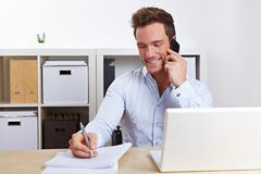 Smiling business man using cell Stock Image