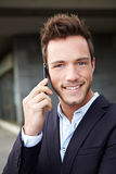 Smiling business man using cell Royalty Free Stock Photo