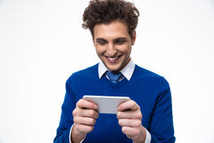 Smiling business man using smartphone Stock Images