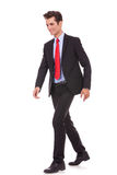 Smiling business man walking Stock Photo