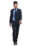 Smiling business man walking forward towards the camera Royalty Free Stock Images