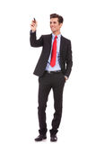 Smiling business man writing with a marker Royalty Free Stock Photography