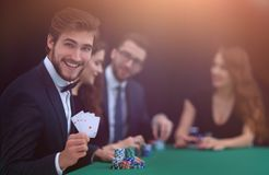 Smiling business man showing four aces royalty free stock photo