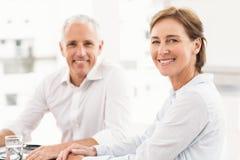 Smiling business partner making an arrangement Royalty Free Stock Image