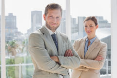 Smiling business partners with arms crossed Royalty Free Stock Photography