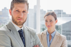 Smiling business partners looking at camera Royalty Free Stock Photos