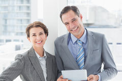 Smiling business partners looking at camera Stock Photos