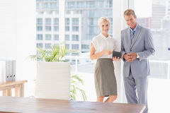 Smiling business partners looking at camera Royalty Free Stock Photo