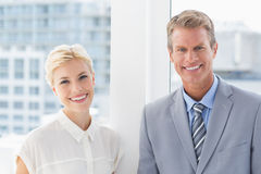 Smiling business partners looking at camera Royalty Free Stock Images