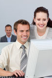 Smiling business partners working at a computer Royalty Free Stock Photography