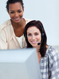 Smiling business partners working at a computer Royalty Free Stock Photos