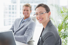 Smiling business partners working together Stock Photos