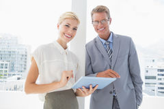 Smiling business partners working together Stock Photo