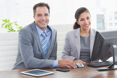 Smiling business partners working together Royalty Free Stock Images
