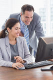 Smiling business partners working together Royalty Free Stock Photo