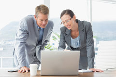 Smiling business partners working together Royalty Free Stock Image