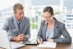 Smiling business partners working together Stock Images