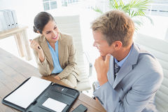 Smiling business partners working together Royalty Free Stock Photos