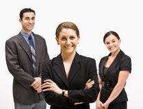 Smiling business people. Three businesspeople smiling at the camera Stock Image