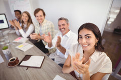 Smiling business people applauding during presentation in office. Portrait of smiling business people applauding during presentation in office Royalty Free Stock Photo