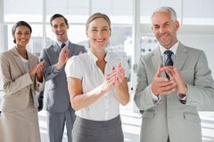 Smiling business people applauding together Stock Photography