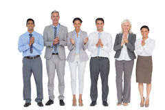 Smiling business people applauding. On white background Stock Photography