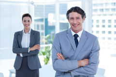 Smiling business people with arms crossed Stock Photo