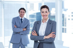 Smiling business people with arms crossed. In an office Stock Photography