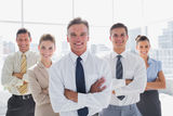 Smiling business people with arms crossed in their office Stock Photo