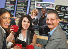 Smiling Business People in Cafe Royalty Free Stock Photos