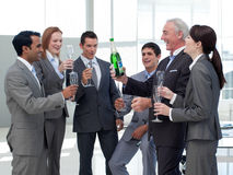 Smiling business people celebrating a success Stock Image