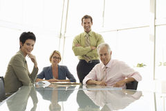 Smiling Business People In Conference Room Royalty Free Stock Photography