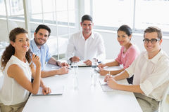 Smiling business people at conference table Royalty Free Stock Images