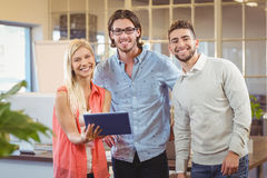 Smiling business people with digital tablet Stock Images