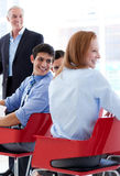 Smiling business people discussing at a conference Stock Photography
