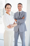 Smiling business people with folded arms Stock Photo